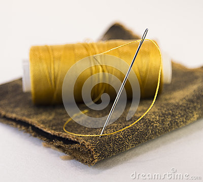 Free Colorful Roll Of Thread On A Piece Of Leather With A Needle. Royalty Free Stock Photo - 65988895
