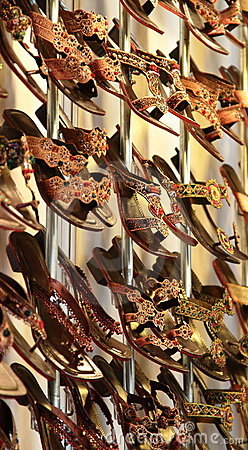 Colorful sandals on rack