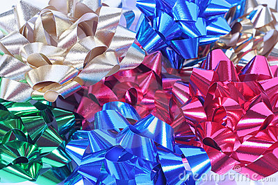 Colorful satin bows in a pile