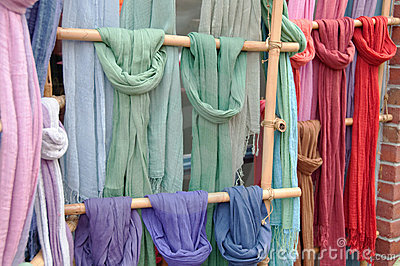 Colorful Scarves on Bamboo Display