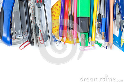 Colorful school supplies in the frame. On a white background.