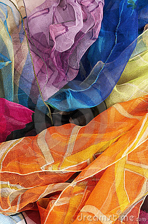 Colorful silk scarves on white background