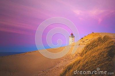 Colorful Sky and Dunes at Rubjerg Knude in Denmark Stock Photo