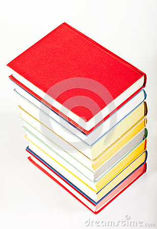 Colorful stacked books on neutral background