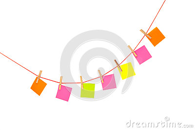 Colorful stickies hanged on red rope