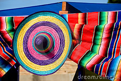 Colorful straw hat and blanket