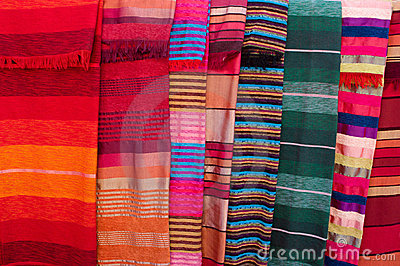Colorful stripy bedcovers on market in Morocco