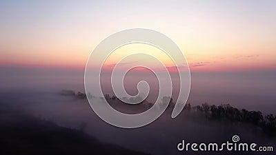 Sunrise above foggy valley. Colorful sunrise above foggy valley viewed from above stock video