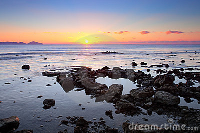 Colorful sunrise on the rocky coast