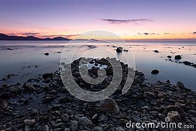 Colorful sunrise on the rocky coast