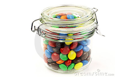 Colorful sweets in a glass jar