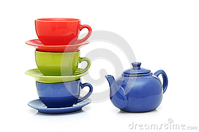 Colorful tea cups with teapot