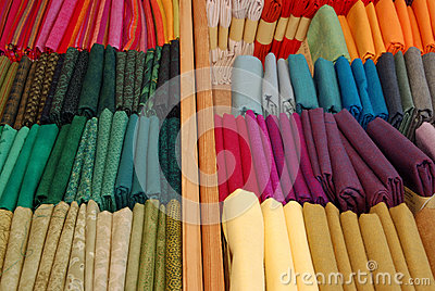 Colorful textile fabrics in small bundles