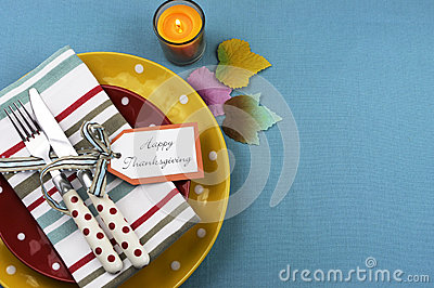 Colorful Thanksgiving dining table setting with copy space.