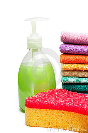 Colorful towels, liquid soap and shower sponge