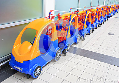 Colorful toy car as trolley in row