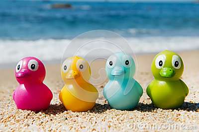 Colorful toy ducks  at beach