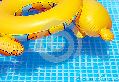 Colorful toy swimming tire at the pool