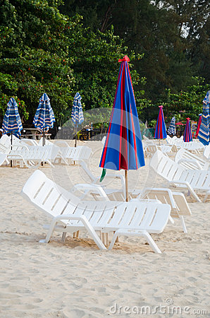 Colorful Umbrella and chair on the beach in Summer at Phuket Tha