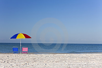 Colorful Umbrella, Pink & Blue Deckchairs on Beach