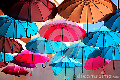 The colorful umbrellas flying towards freedom Stock Photo