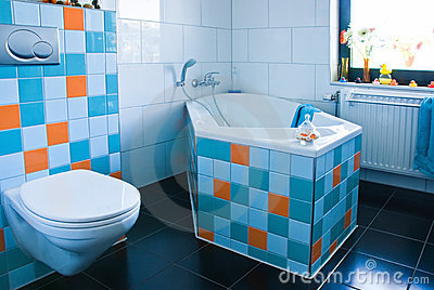 Colorful white and blue bathroom with black floor