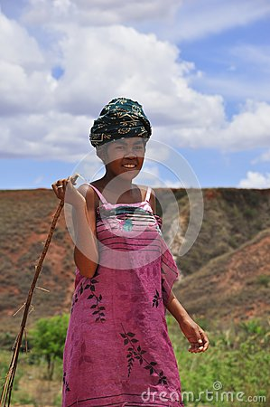 Colorful women with stick in Madagascar Editorial Stock Image