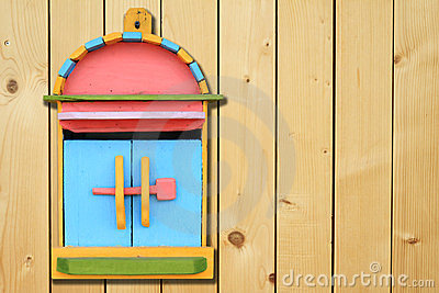 Colorful wood mailboxes on wood wall