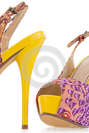 Colorful yellow women stiletto shoes, on white