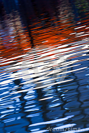 The colors are reflected in the water.