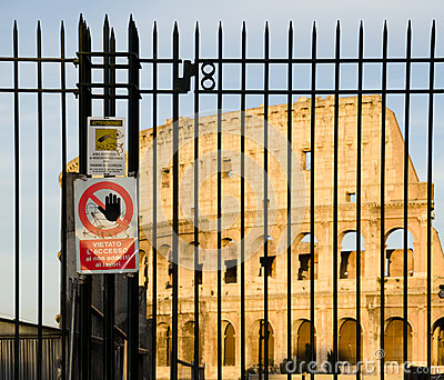 Colosseum behind the bars in Rome, Italy