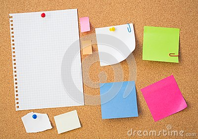 Colour note papers on pin board.