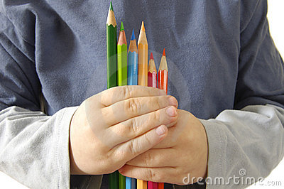 Colour pencils ahd children in hands