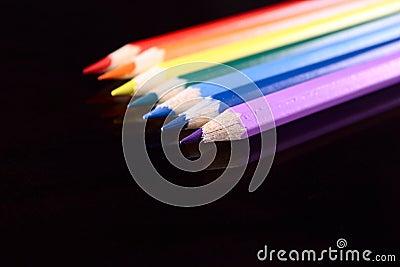 Colour pencils on dark glass