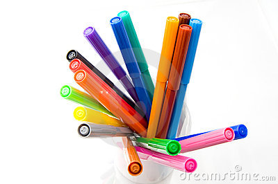 Colour pens in a glass isolated on white