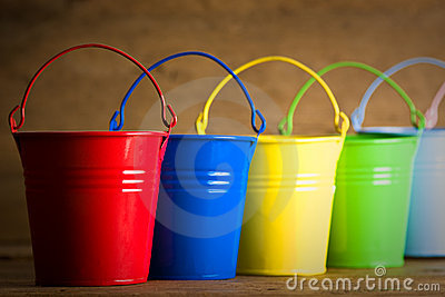 Coloured buckets on the floor