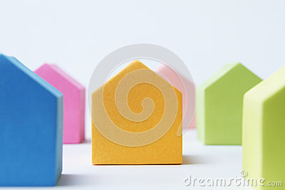 Coloured House Shaped Blocks On White Background