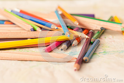 Coloured pencils scattered on table. crayons