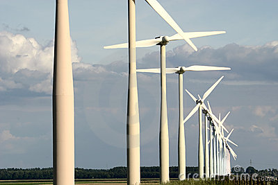 Coloured wind turbines in a row