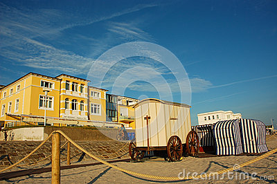 Colourful bathing machine and strandkorbs at North Sea Editorial Stock Photo