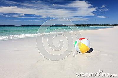 Colourful beach ball on the seashore by the ocean