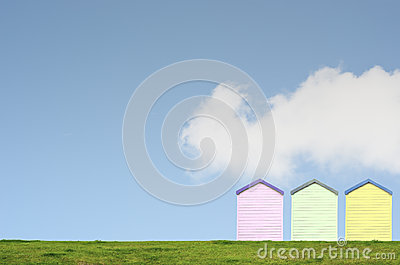 Colourful Beach Huts on Blue Sky