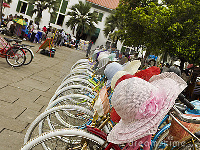 Colourful bicycles and hats for hire Editorial Photography