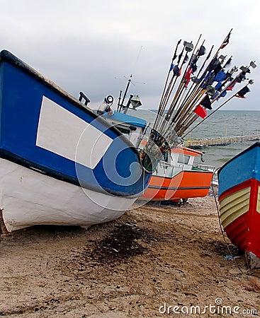 Colourful boats on beach.