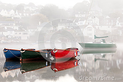 Colourful Boats in Misty Devon Harbour