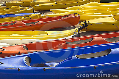 Colourful canoes lie in two rows