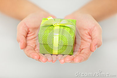 Colourful green gift in cupped hands