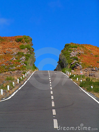 The colourful hill deeply cut by the road. Madeira