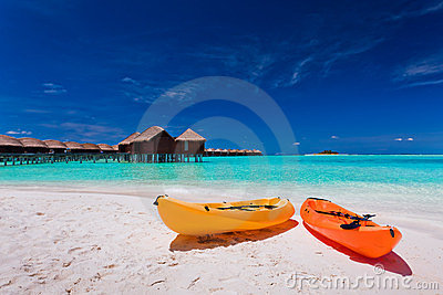 Colourful kayaks on the tropical beach