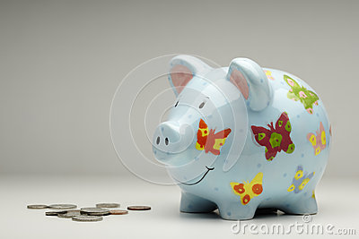 Colourful piggy bank with money